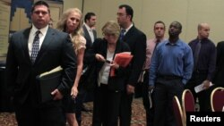 People wait in line to meet with recruiters during a job fair in Melville, New York, July 19, 2012.