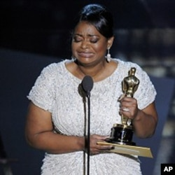 "Octavia Spencer accepts the Oscar for best actress in a supporting role for ""The Help"" during the 84th Academy Awards on Sunday, Feb. 26, 2012, in Hollywood."