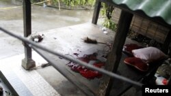 The blood of a terror suspect is seen at the site of a shooting in a rented villa in Sanur on the Indonesian island of Bali, March 19, 2012.