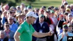 Danny Willett, of England, celebrates on the 18th hole after finishing the final round of the Masters golf tournament Sunday, April 10, 2016, in Augusta, Georgia.