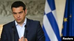 PM Yunani Alexis Tsipras dalam konferensi pers di Athena, Rabu (17/6). Yunani terancam mengalami kegagalan bayar utang (default).