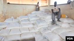 FILE - Bags of maize are seen in a distribution center at Dzaleka refugee camp in Malawi (L. Masina/VOA).