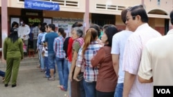 Voters line up in Kampong Cham town, northeast of Cambodia's capital Phnom Penh.