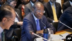 President of Guinea Alpha Conde, center, listens as the heads of the United Nations, the International Monetary Fund and the World Bank discuss the Ebola outbreak at the World Bank in Washington, Oct. 9, 2014.