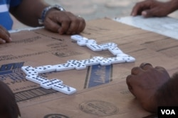 A game of dominoes being played in Colombia.