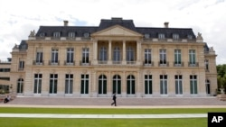 FILE - The Organization for Economic Cooperation and Development headquarters is pictured in Paris, June 7, 2017. Nearly 140 countries have agreed on a tentative deal to change how big, multinational companies are taxed.