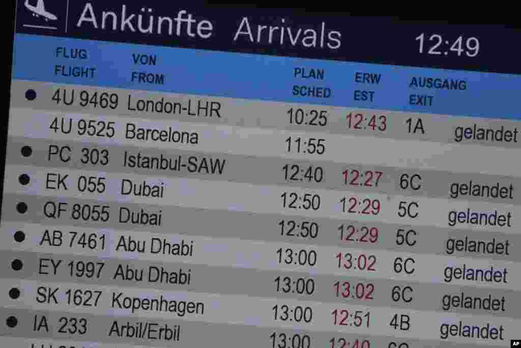 The arrivals board shows Flight 4U 9525 from Barcelona without a status advisory at the airport after a Germanwings passenger jet carrying more than 140 people crashed in the French Alps region, in Duesseldorf, Germany, March 24, 2015.