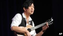 FILE - Jake Shimabukuro performs during the PBS Winter TCA Tour at the Langham Huntington Hotel in Pasadena, Calif., Jan. 15, 2013.