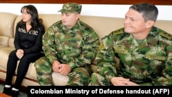 Brigadier General Ruben Alzate, right, Corporal Jorge Rodriguez, center, and lawyer Gloria Urrego were released by the FARC guerrillas in Medellin, Colombia, Nov. 30, 2014.