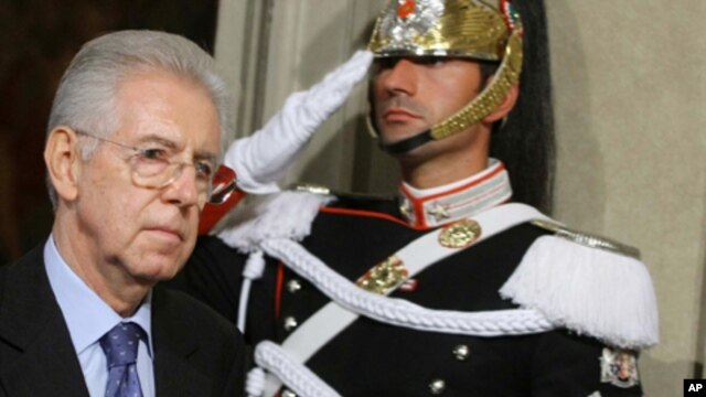 Italy's new premier-designate economist Mario Monti walks past a Cuirassier presidential guard at the Quirinale Presidential Palace in Rome after talks with Italian President Giorgio Napolitano, Sunday, Nov. 13, 2011.