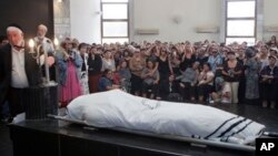 Israeli and American officials are blaming the Lebanese militant group Hezbollah for the July 18, 2012 bombing that killed five Israeli tourists, a Bulgarian bus driver and the bomber in Burgas, Bulgaria. Shown here is a funeral for one of the Israeli vic
