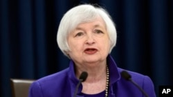 Kepala Federal Reserve, Janet Yellen memberikan keterangan kepada pers di Washington, setelah bank sentral AS menaikkan suku bunga acuan 0,25 persen hari Rabu (16/12).