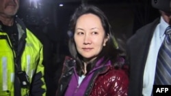 FILE - This TV image shows Huawei Technologies Chief Financial Officer Meng Wanzhou as she exits the court registry following the bail hearing at British Columbia Superior Courts in Vancouver, British Columbia, Dec. 11, 2018.