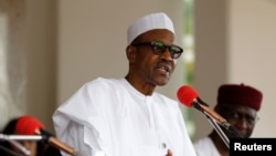 FILE - Nigerian President Muhammadu Buhari speaks at the presidential villa in Abuja, Nigeria.