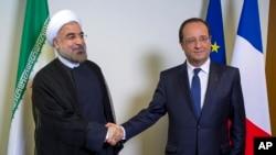 دیدار فرانسوا اولاند رئیس جمهوری فرانسه (راست) و حسن روحانی رئیس جمهوری ایران در حاشیه مجمع عمومی سازمان ملل متحد - سپتامبر ۲۰۱۳
