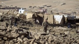 A U.S. soldier stands guard at the site of suicide attack in Wardak Province of Kabul Afghanistan, Friday, Nov, 23, 2012.