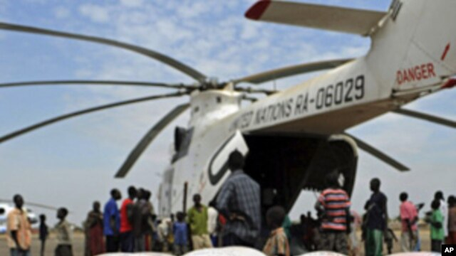Relief food of the World Food Program is offloaded in Pibor, South Sudan, Jan 12, 2012.