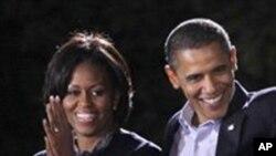 President Barack Obama, Michelle Obama. AP