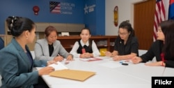 Five Cambodian women entrepreneurs discuss during a meeting at the U.S. Embassy in Phnom Penh, before they head to the United States to take part in a leadership program sponsored by the U.S. State Department, in Phnom Penh, Sept. 10, 2018. (Rick Albertson, U.S. Embassy in Cambodia)