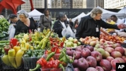 People buy fresh fruits and vegetables at an open-air farmers market in downtown Chicago. (AP Photo/M. Spencer Green)