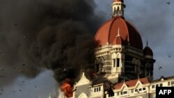 Flames engulf the Taj Mahal Hotel in Mumbai, on November 27, 2008.