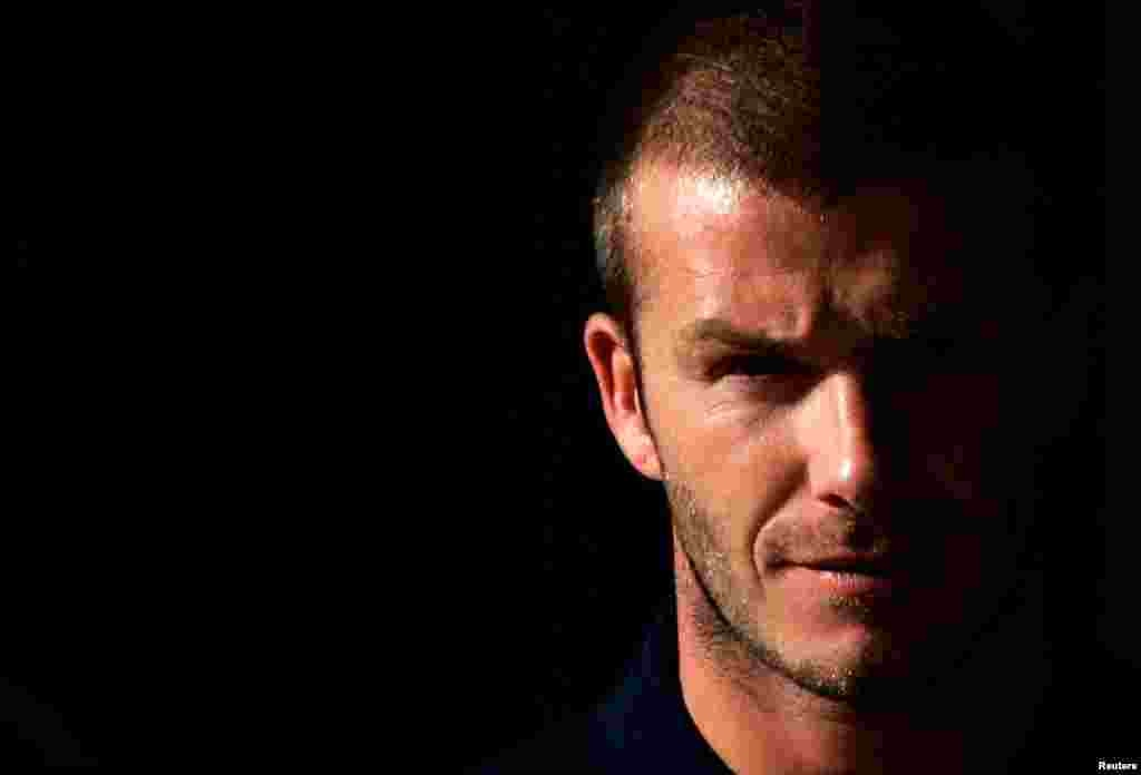 David Beckham arrives at a news conference in Sydney, November 25, 2007. He announced his retirement from football May 16, 2013.