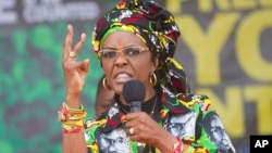 FILE - Zimbabwe's former first lady, Grace Mugabe, addressing party supporters at a ZANU PF rally in Chinhoyi on July 29, 2017.