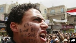An anti-government protester shouts slogans during a rally demanding the ouster of Yemen's President Ali Abdullah Saleh in Sana'a, March 19, 2011