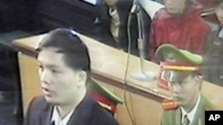 Human rights lawyer Nguyen Van Dai, left, is seen in this picture shot through close-circuit TV set up in the court during his trial in Hanoi, Vietnam Tuesday, Nov. 27, 2007.
