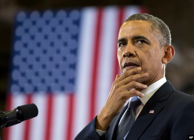 President Barack Obama pauses as he speaks at McGavock High School, Jan. 30, 2014, in Nashville, Tennessee.