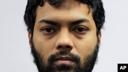 This undated photo released by the Ministry of Home Affairs shows Rahman Mizanur, one of four Bangladeshi men convicted in a Singapore Court on Tuesday, May 31, 2016.