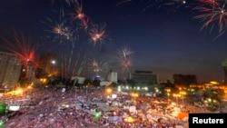 Fireworks burst over opponents of Egypt's Islamist President Mohamed Morsi, in Tahrir Square in Cairo, Egypt, July 2, 2013.