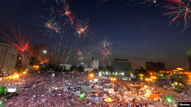 Fireworks burst over opponents of Egypt's Islamist President Mohamed Morsi, in Tahrir Square in Cairo, Egypt, July 2, 2013.