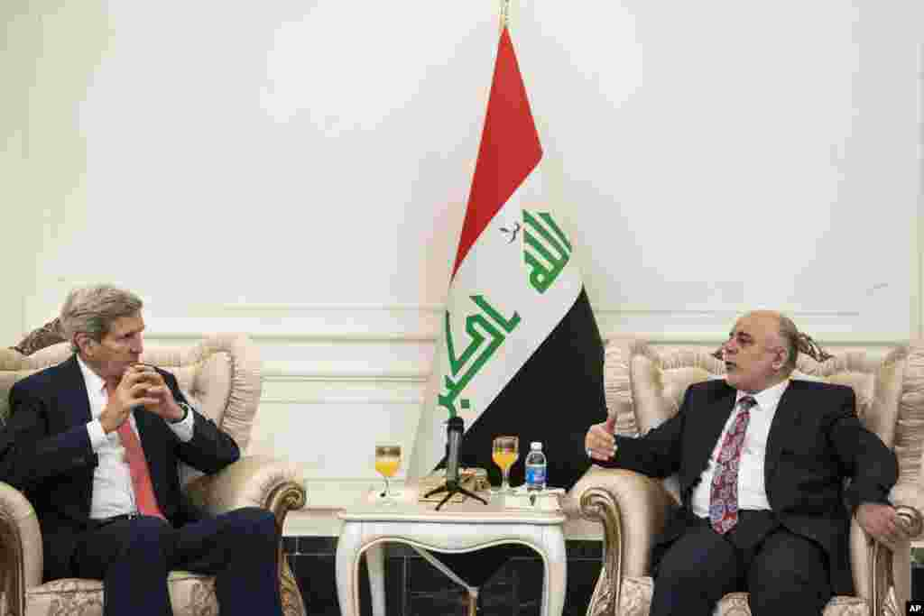 U.S. Secretary of State John Kerry, left, listens to new Iraqi Prime Minister Haider al-Abadi during a meeting in Baghdad, Iraq, Sept. 10, 2014.