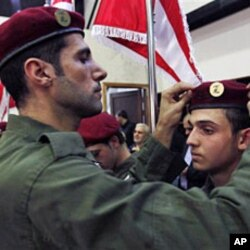 A Hezbollah fighter fixes the beret of a fellow member during a speech by Hezbollah leader Hassan Nasrallah in the southern suburb of Beirut (File)
