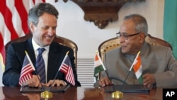 Treasury Secretary Timothy Geithner, left, and Indian Finance Minister Pranab Mukherjee smile after signing a joint statement on the U.S.-India Economic and Financial Partnership, Tuesday, June 28, 2011