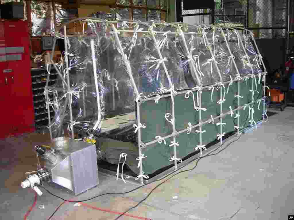 Center for Disease Control photo showing an Aeromedical Biological Containment System which looks like a sealed isolation tent intended for Ebola air transportation, July 31, 2014.