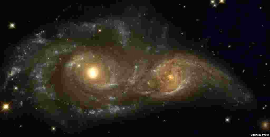 The near collision of two spiral galaxies taken by NASA's Hubble Space Telescope and its Wide Field Planetary Camera 2 on Nov. 4, 1999. (NASA)