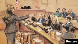 """Assistant U.S. Attorney Andrea Goldbarg points at Mexican drug lord Joaquin """"El Chapo"""" Guzman, back row center, in this courtroom sketch during Guzman's trial in Brooklyn federal court in New York City, Jan. 30, 2019."""