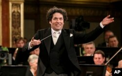 FILE - Maestro Gustavo Dudamel of Venezuela conducts the Vienna Philharmonic Orchestra during the traditional New Year's Concert at the Golden Hall of the Musikverein in Vienna, Austria, Jan. 1, 2017.