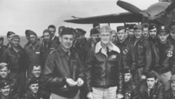 Lt. Col. Jimmy Doolittle accepts a medal from the skipper of the USS Hornet, Capt. Marc A. Mitscher.