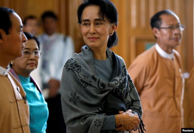 National League for Democracy (NLD) party leader Aung San Suu Kyi smiles as she arrives to attend Union Parliament in Naypyitaw, Myanmar, Jan. 28, 2016.