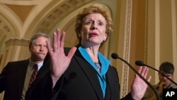 Sen. Debbie Stabenow, D-Mich., chairwoman of the Senate Agriculture Committee, speaks to reporters, June 10, 2013.
