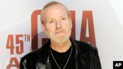 FILE - Singer Gregg Allman arrives at the 45th Annual CMA Awards in Nashville, Tennessee, Nov. 9, 2011.