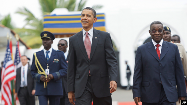 President Barack Obama walks with Ghana President John Atta Mills, right, at the Presidential Palace in Accra, Ghana, Saturday, July 11, 2009.