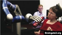 Cathy Hutchinson drinking from a bottle using the robotic arm