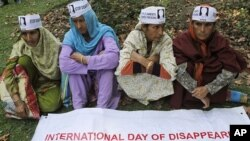 Relatives of missing Kashmiri youths participate in a protest organized by the Association of Parents of Disappeared Persons in Srinagar, India, August 29, 2011