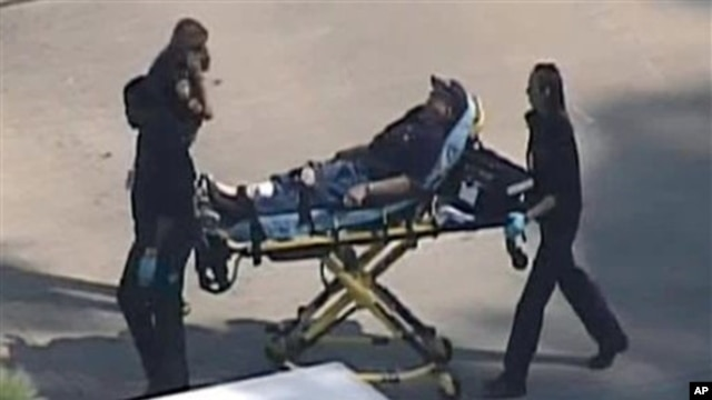 An unidentified person is transported by emergency personnel at Lone Star College in Houston, Texas Jan. 22, 2013 (Courtesy KPRC TV)