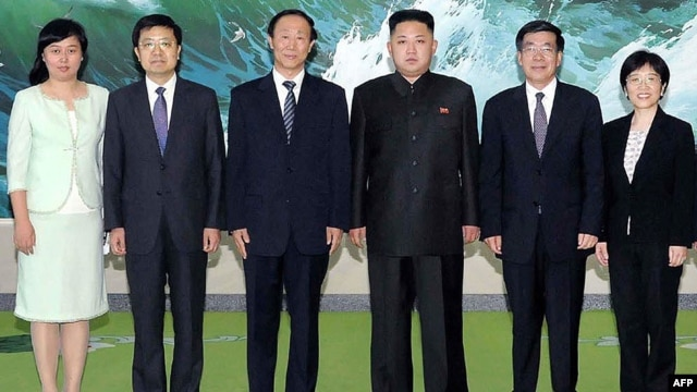 North Korean leader Kim Jong-Un (3rd R) photographed with the delegation of the International Liaison Department of Chinese Communist Party led by Wang Jiarui (3rd L) in Pyongyang, August 3, 2012.