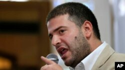 Osama Morsi, son of ousted Egyptian President Mohamed Morsi, speaks during a press conference in Cairo, July 22, 2013.